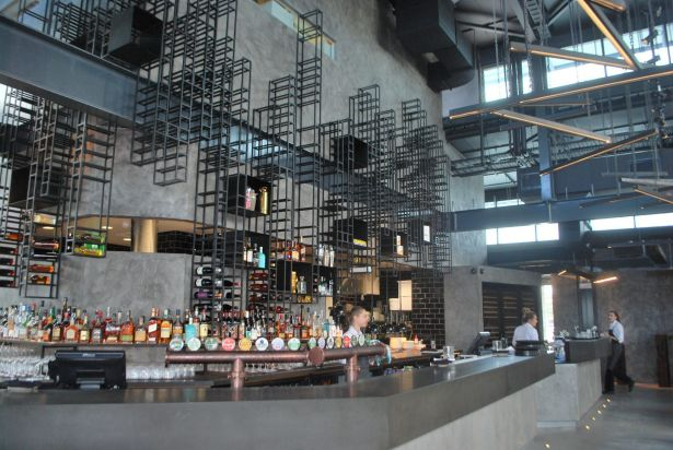 The bar at The Deck, the casual dining space at Ku De Ta Perth.