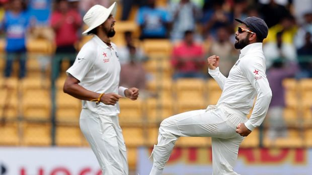 Happier times: India's captain Virat Kohli, right, celebrates during the second Test in India.
