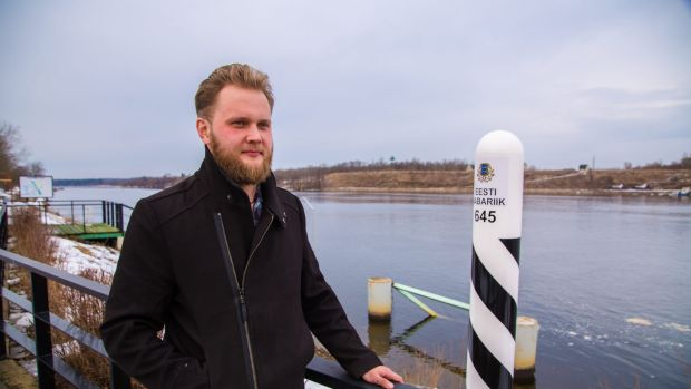 Estonian Stanislav Pupkevich looks over the river towards Russia.