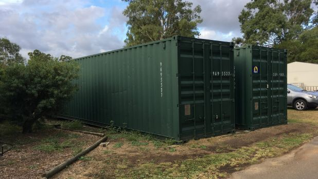 The shipping containers used to store chest X-rays of thousands of Queensland coal workers at Redbank.