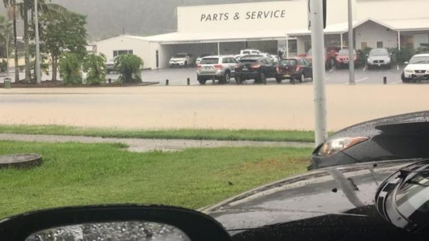 Flooding turned Halls Road, Coffs Harbour, into a brown river on Wednesday.