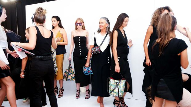 Model Lou Kenny (centre), pictured backstage, starred in the Vogue Runway at the Melbourne Fashion Festival on Wednesday ...