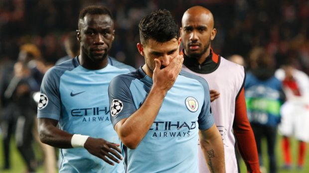 Stunning loss: Man City's Sergio Aguero leaves the pitch.