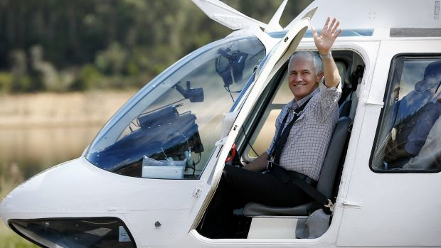 Prime Minister Malcolm Turnbull boards a helicopter to take an aerial tour of Snowy Hydro Tumut 3 power station, at ...