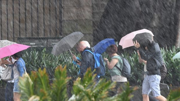 Umbrellas at the ready: Sydney bracing for a wet weekend.