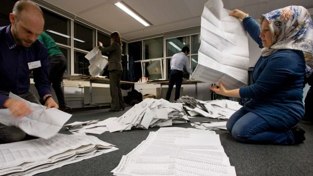 Ballot papers are sorted and hand counted at the mayor's office in The Hague on Wednesday.
