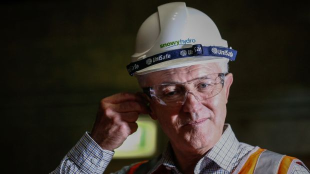 Prime Minister Malcolm Turnbull puts in ear plugs during a visit to the Snowy Hydro plant.
