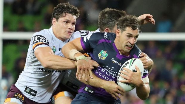 Billy Slater of the Storm is tackled.