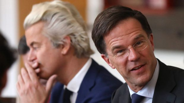Dutch Prime Minister Mark Rutte sits next to Geert Wilders.