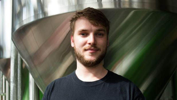"""Student Rhys Raymond-Jones, at Rocks Brewing Co, says making his own beer during his internship was """"a home brewer's dream""""."""