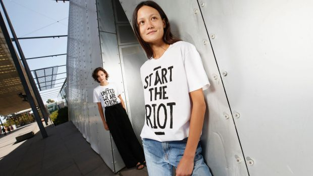 Models Nicola Clarke and Rachal Rutt show off some House of Riot T-shirts on Friday.