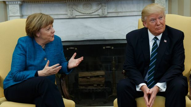 President Donald Trump meets with German Chancellor Angela Merkel in the Oval Office.