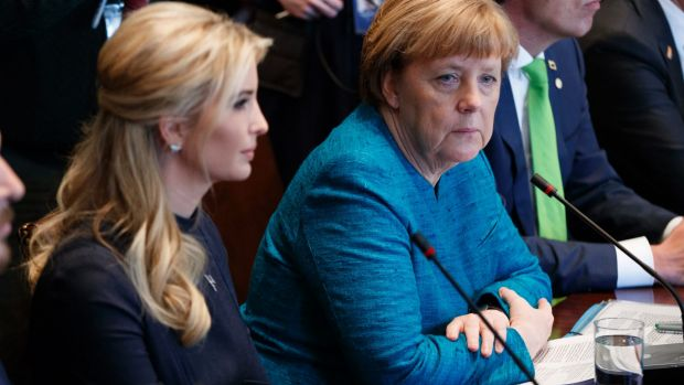 German Chancellor Angela Merkel sits next to Ivanka Trump during a roundtable discussion.