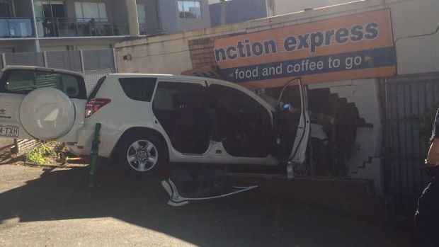 An SUV crashes into a Bowen Hills shop, trapping the driver and causing structural damage to the business.