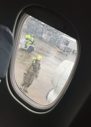 Passenger Alyce Fisher's photograph of emergency services outside the plane.