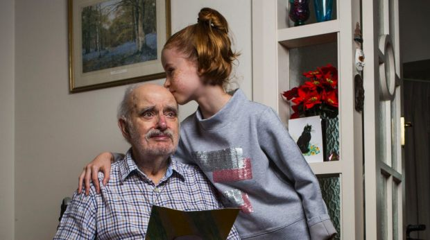 Grandfather James Bradley, 92, and his granddaughter Karis Town, 9, at home in Croydon.