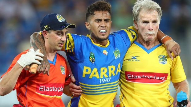 In hospital: Kaysa Pritchard leaves the field during the Eels clash with the Titans on Friday.