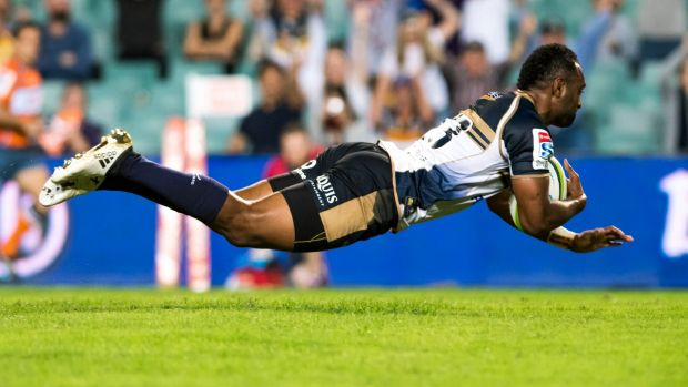No sidestep: Kuridrani crosses for the Brumbies after barging past Nick Phipps.