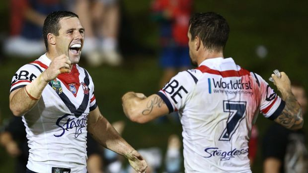 Centre of the action: Gordon celebrates his late try with Mitchell Pearce.