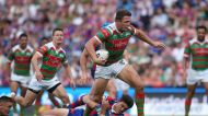 NEWCASTLE, AUSTRALIA - MARCH 18:  Sam Burgess of the Rabbitohs is tackled during the round three NRL match between the ...