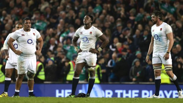 Shocked: England players come to terms with their loss against Ireland.