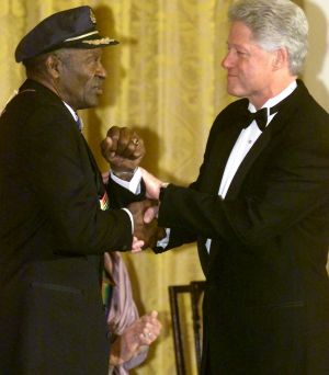 U.S. President Bill Clinton shakes hands with Chuck Berry during a ceremony at the White House in Washington, 2000.