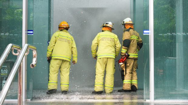 Firefighters respond to a fire alarm and building evacuation on Turbot Street, Brisbane.