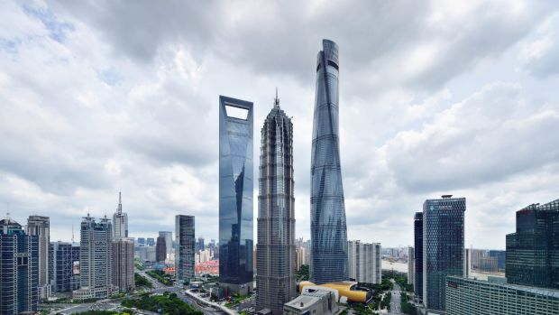 The Shanghai skyline features dramatic skyscrapers.