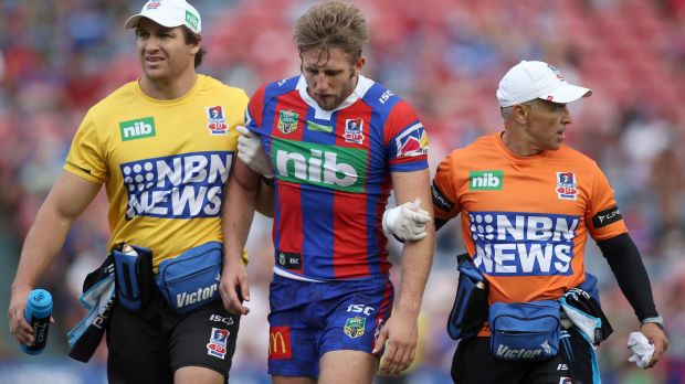 Brendan Elliot of the Knights leaves the ground after getting injured.