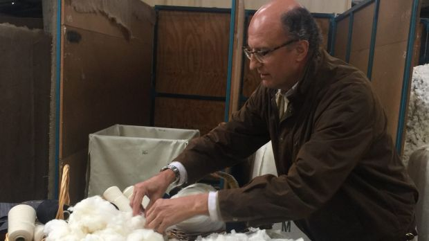 Fashionable farming: Paolo Zegna samples the wool at Achill Farm.