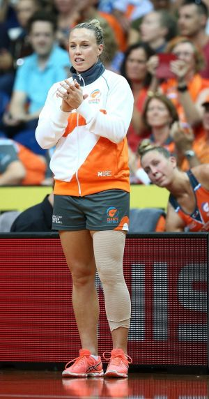 Giants captain Kim Green cheers from the sideline after her injury.