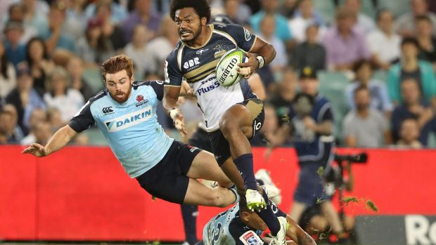 Speed bump: The Waratahs stumble over themselves trying to stop Henry Speight.