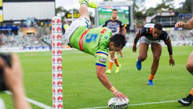Acrobatic: Josh Rapana launches himself for the try line.