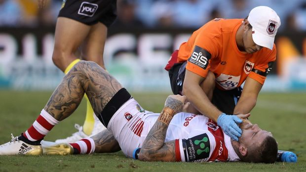 Floored: Josh Dugan lay motionless for 30 seconds after copping an elbow to the face from teammate Russell Packer.