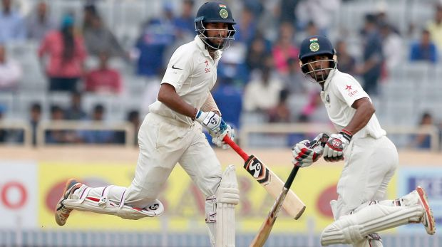 Chief tormenters: Cheteshwar Pujara and Wriddhiman Saha keep the Australians busy.
