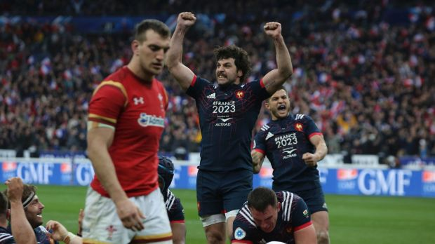 Thrilling: France celebrate their late, late win over Wales.