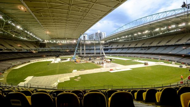 Workers at Melbourne's Etihad Stadium break down the stage after Adele's Sunday night concert. The ground will host a ...