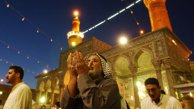 Pilgrims pray at the Imam Hussein shrine in Karbala, to mark the end of the 40-day mourning of the death of Imam Hussein.
