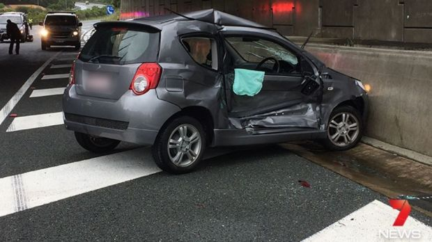 Police said the oncoming car lost control due to the wet conditions, hitting the police officer and his patrol car.