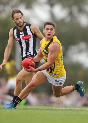 Dion Prestia finds some space during the pre-season match against Collingwood at Ted Summerton Reserve.