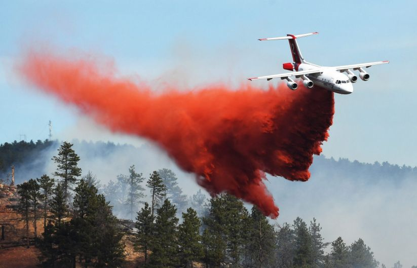 Fire crews fight a wildfire from the air in Sunshine Canyon, in Boulder, Colorado.