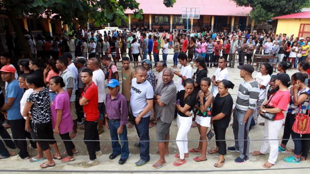 People queue up to give their vote during the presidential election at a polling station in Dili, East Timor,.
