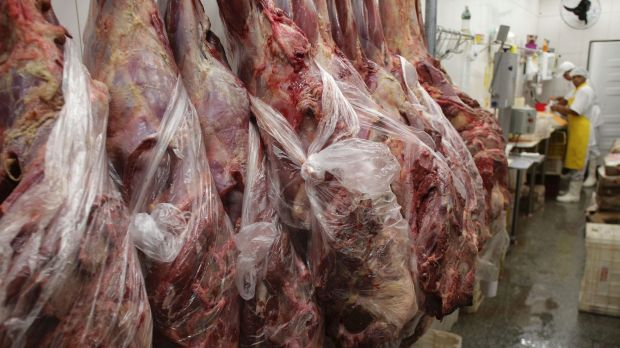 Employees work in a butcher shop in Brasilia on Monday.