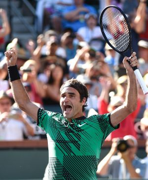 Roger Federer enjoys the moment after defeating Stan Wawrinka in the men's final of the BNP Paribas Open at Indian Wells.
