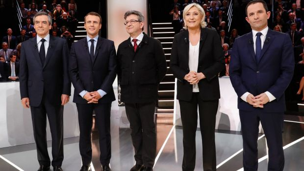 Candidates from left:Francois Fillon, Emmanuel Macron, Jean-Luc Melenchon, Marine Le Pen and Benoit Hamon pose before ...