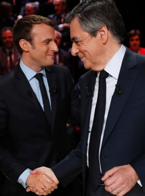 Emmanuel Macron, left, greets Francois Fillon.