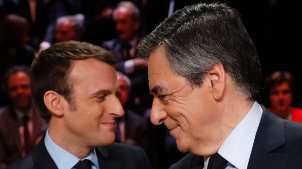 Emmanuel Macron, left, greets Francois Fillon .
