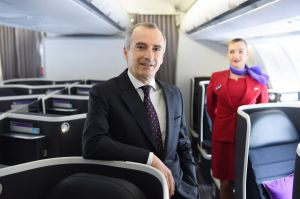 Virgin boss John Borghetti has been rewarded for getting cash-flow under control and executing on the airline's ...