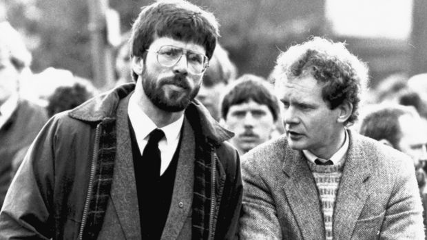 Sinn Fein president Gerry Adams, left, stands with Martin McGuinness at the funeral of an Irish Republican Army ...