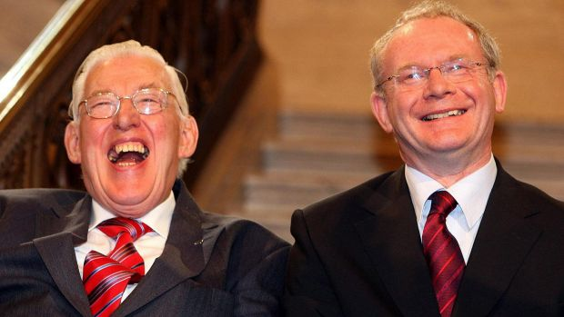 Northern Ireland's first minister Ian Paisley and deputy first minister Martin McGuinness smile after being sworn in  at ...